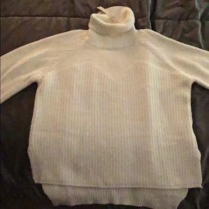 Warm white sweater.